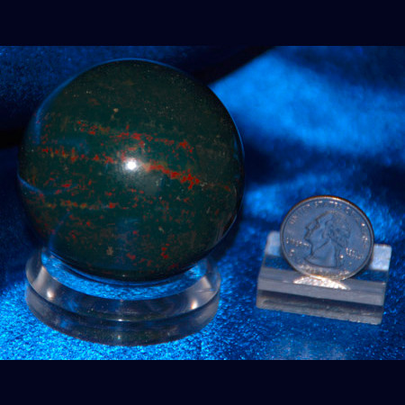 "A polished Bloodstone Sphere. An excellent gift or piece of decor for any home or office. An acrylic stand is included with purchase. Dimensions: 2.1"" Diameter. Wt: 0.6 Lbs You will receive the item shown. Bloodestone Polished Sphere 1029"
